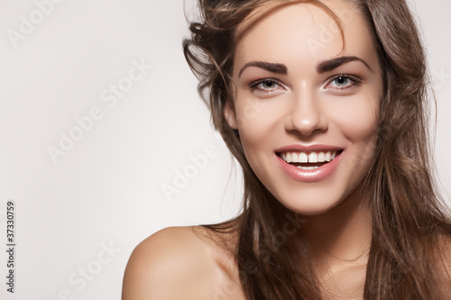 Happy beautiful woman. Female smile with healthy white teeth