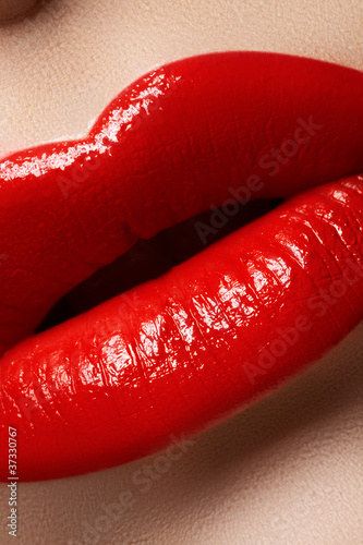 Macro of lips with bright fashion red makeup. Bloody lipstick