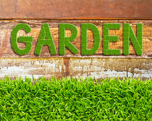 green grass garden word on wood background