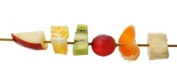 Slices of fruit on a wooden stick
