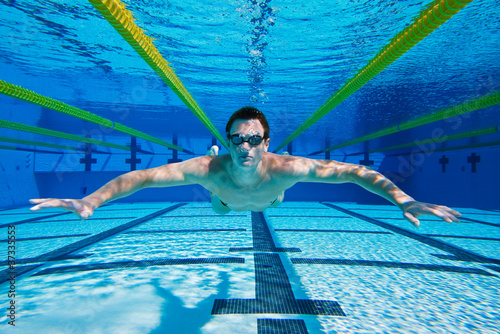 Swimmer in the Pool floating Underwater