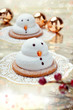 Two marshmallow snowmen biscuits with Chistmas decorations