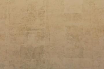 Оштукатуренная стена в качестве фо