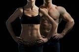 Kobieta i mężczyzna w siłowni - 37337907