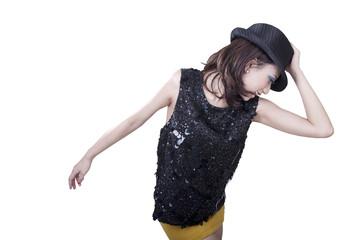 Beautiful woman dancing wearing fedora