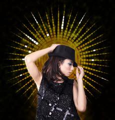 Woman with fedora dancing in a nightclub