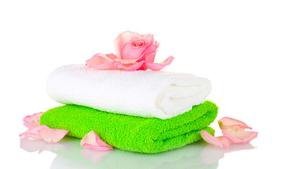 Towel and flower isolated on white