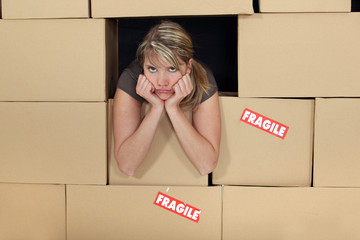 Bored woman surrounded by boxes