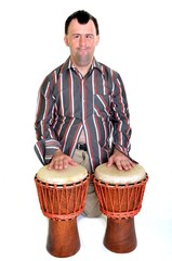 down syndrome man playing on africain percussion