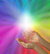 Hands and cross on rainbow background