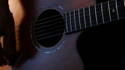 Musician strumming guitar