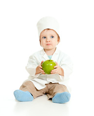 Adorable boy uniformed as doctor with green apple over white