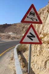 Dangerous Curves Ahead - traffic sign at the desert