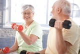 Vital senior couple in the gym - 37357306