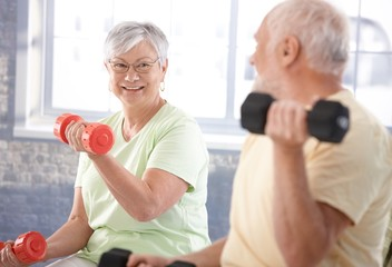 Vital senior couple in the gym