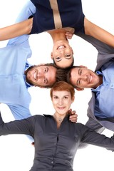 Smiling businesspeople embracing