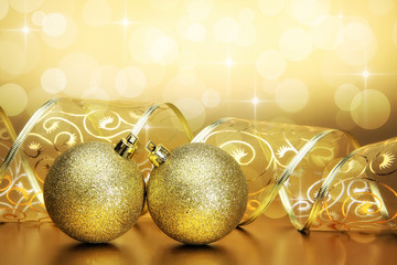Christmas baubles, ribbon and bokeh background