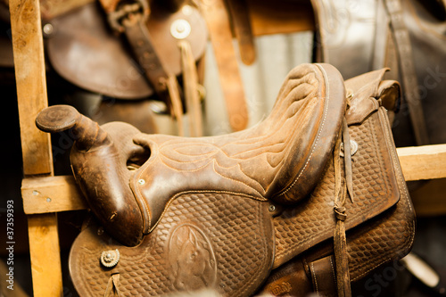 Horse Saddles in a Tack Room