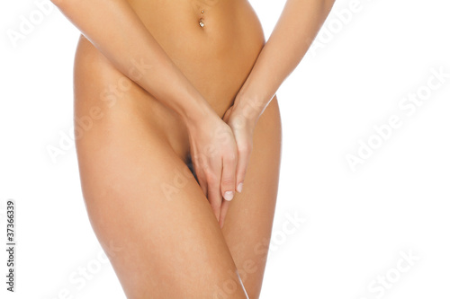 close up of a woman body with close hands between the legs