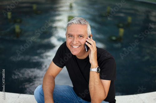 Handsome middle age man outdoors
