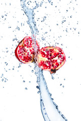 Fresh pomegranate in water splash
