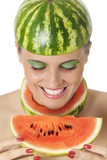 Happy young woman looking at water melon