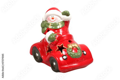 Santa Claus in a car figurine over white with clipping path.