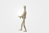 Wooden Manikin Doll With Light Bulb poster