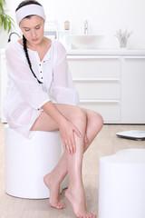 portrait of a woman massaging her leg
