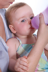 Baby drinking water from a bottle