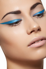 Beautiful model with bright spring eyeliner make-up, clean skin