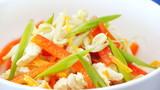 Rotating bowl of vegetable salad. Japanese cuisine.