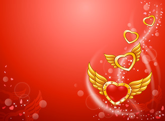 Winged flying golden hearts