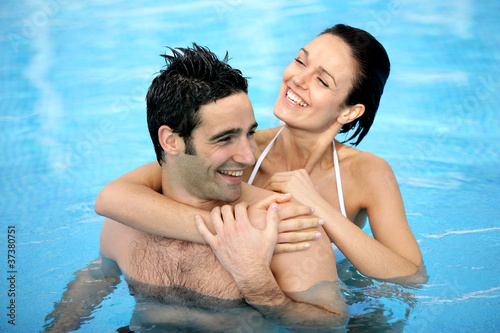 Couple hugging in swimming pool