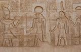 Carving of gods on wall in Kom Ombo temple, Egypt