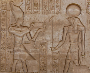 Egyptian engraved gods on wall in Kom Ombo temple, Egypt
