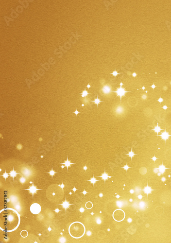 Gold background with circle light effects and shiny stars
