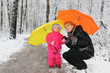 Grandmother and little granddaughter with umbrella