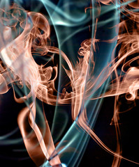 Abstract colorful smoke on black background.