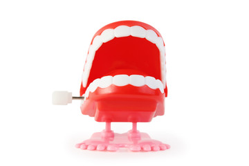 toy clockwork open jaw with white teeth on pink legs