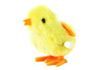 bright toy clockwork fluffy yellow chick with orange feet