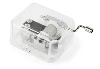 little clockwork toy transparent musical box on white