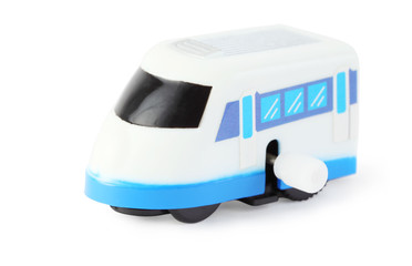 bright clockwork toy white train with blue windows on white