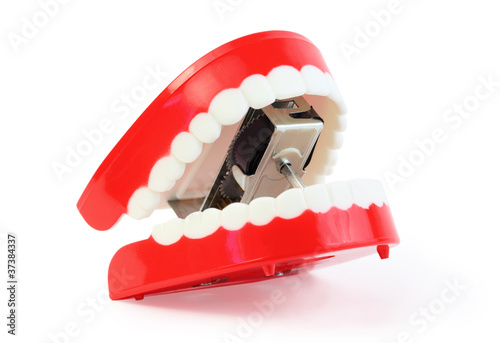 small toy jaw with white teeth swallowed mechanism on white