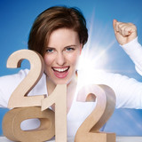 Young woman enjoys New Year´s Eve 2012 poster