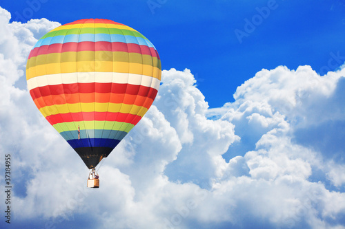 Deurstickers Ballon colorful hot air balloon on nice cloudy blue sky