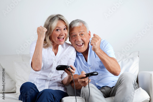 Couple Having Fun Playing Video Game