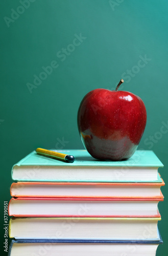 Books and apple