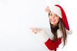 Female Santa pointing at a banner
