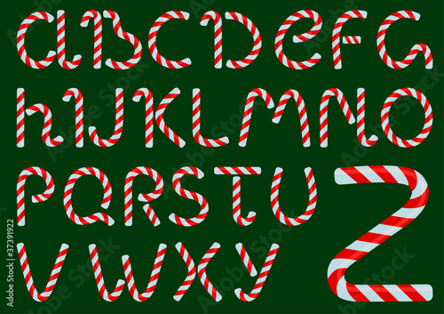 Vector Christmas candles alphabet on a green background